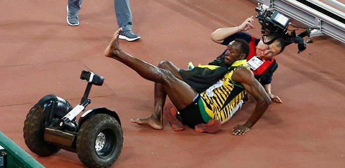 Camarógrafo atropella a Usain Bolt